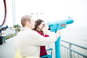 engagement photo looking through telescope