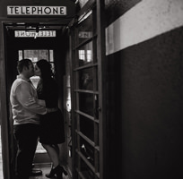 engagment photo black and white kissing in phone booth
