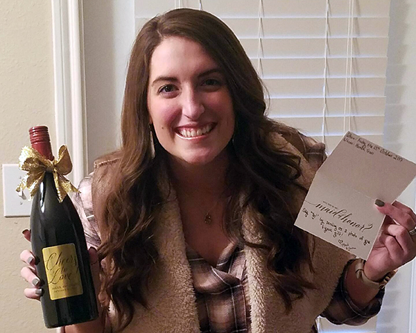 Katy Curtsinger with maid of honor asking gift